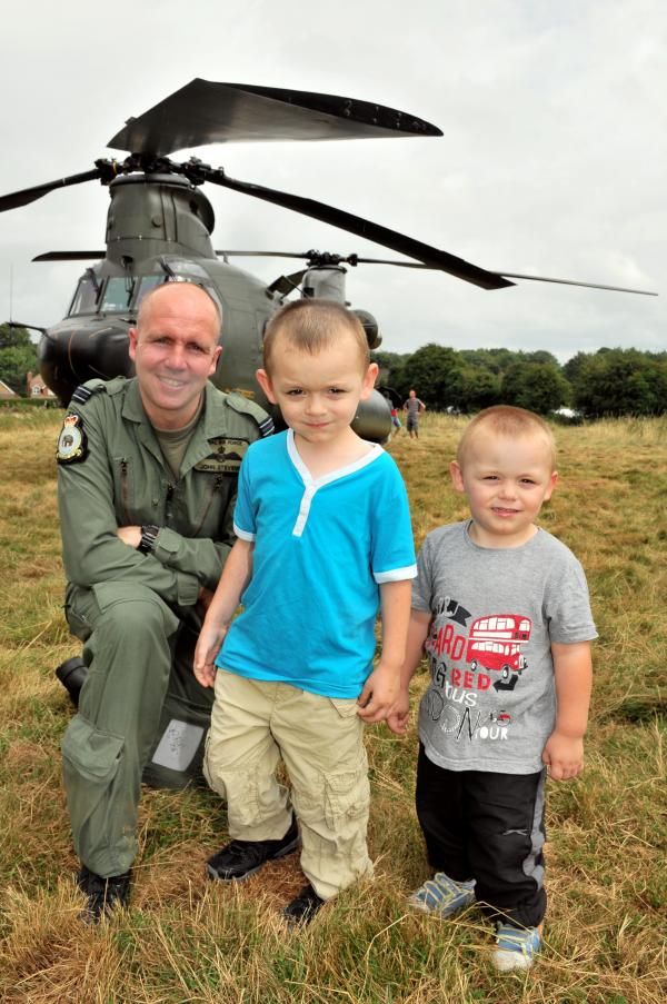 Flt Lt John Stevens, from RAF Odiham, with Tyler Haw-Davidson, four, and Hayden Haw-Davidson, two, from Old Basing