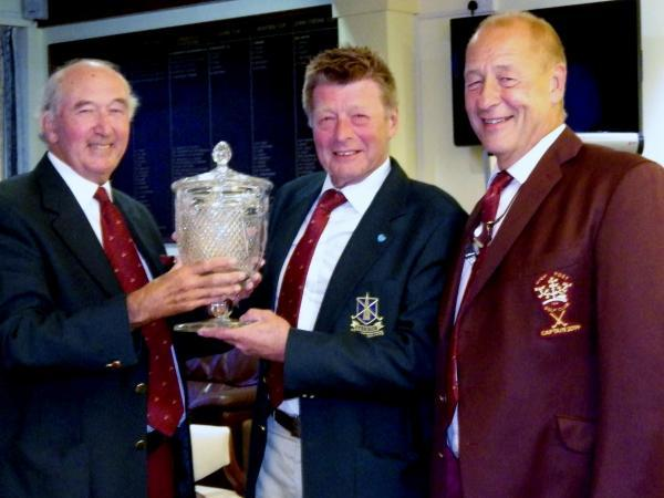 Club captain Brian Hutchins, left, presenting the trophy to Richard Boyland, watched by High Post captain Dave Fitz-Henry