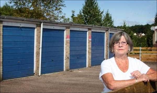 Jean Hughes outside her garage