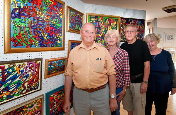 Abstract artist John Barnes, foreground, with some of his work and other society members, left to right, Jeanne Titchiner, Keith Pattison and Jacqui Novis
