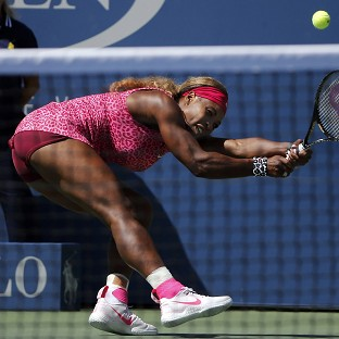 Serena Williams, pictured, breezed past Vania King 6-1 6-0 despite windy conditions (AP)