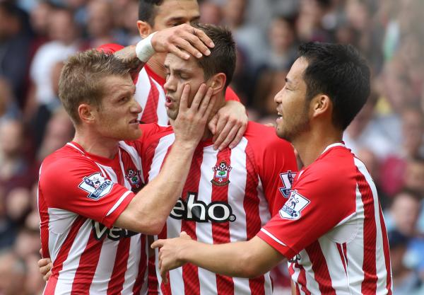 Morgan Schneiderlin is congratulated by Steven Davis, Jose Fonte and Maya Yoshida after scoring his first goal at West Ham