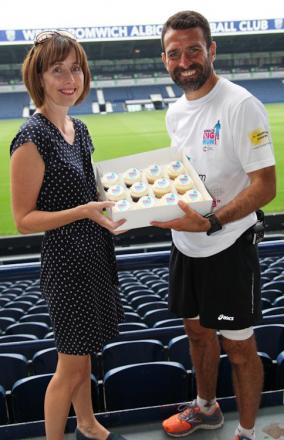 Francis Benali takes delivery of some Benali's Big Run cupcakes at West Brom.