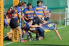 Several Gosport defenders are unable to prevent Basingstoke's Gavin Hart scoring a try