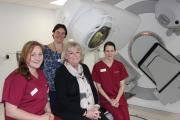 Pauline Wren with radiographers Leanne Rowan (left) and Louise Hay (right) and Holly Hall (back), radiography services manager in the new treatment room
