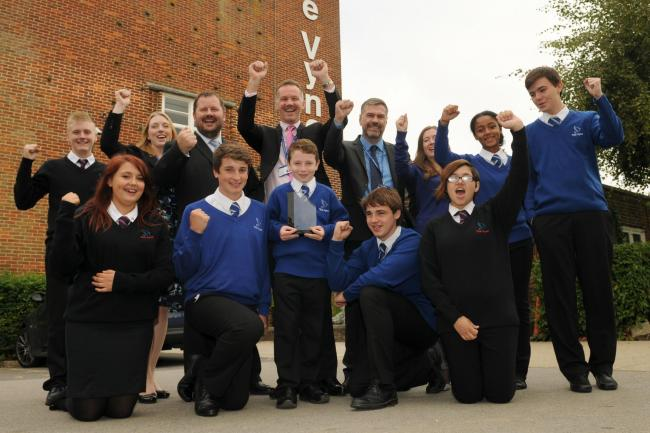 The Vyne Community School's headteacher Mark Kingswood, fourth left in back row, celebrates The Vyne's award with pupils and fellow teachers
