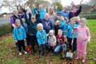 Beaver Scouts plant spring bulbs outside Tadley Council Offices