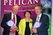 Professor Bill Heald, left, with Pelican chief executive Sarah Crane and surgeon Brendan Moran