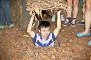 A guide demonstrating how the Vietcong hid in the Cu Chi Tunnels
