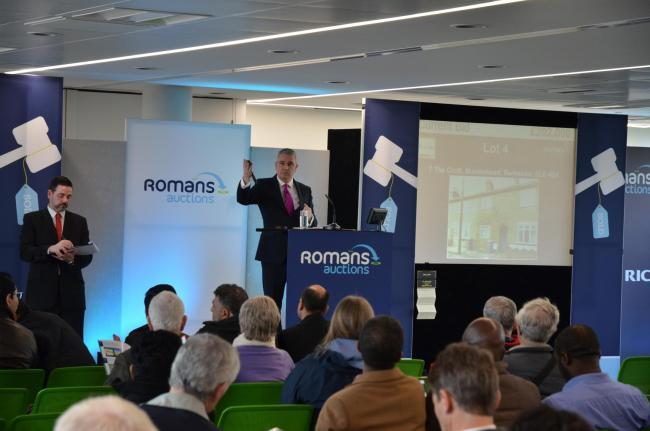 Romans' auctions director, Simon Clayton, in action earlier this year