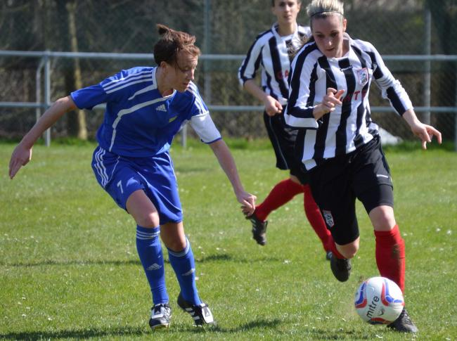 Basingstoke's Charlie Fry challenges a Maidenhead United player for the ball