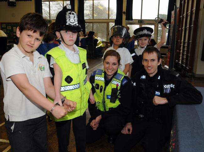 From left: Arthur, Alfie, Hasan and Luke from Year 3, with PCSO Steph Bradley and PC Aaron Webb, from Basingstoke police station