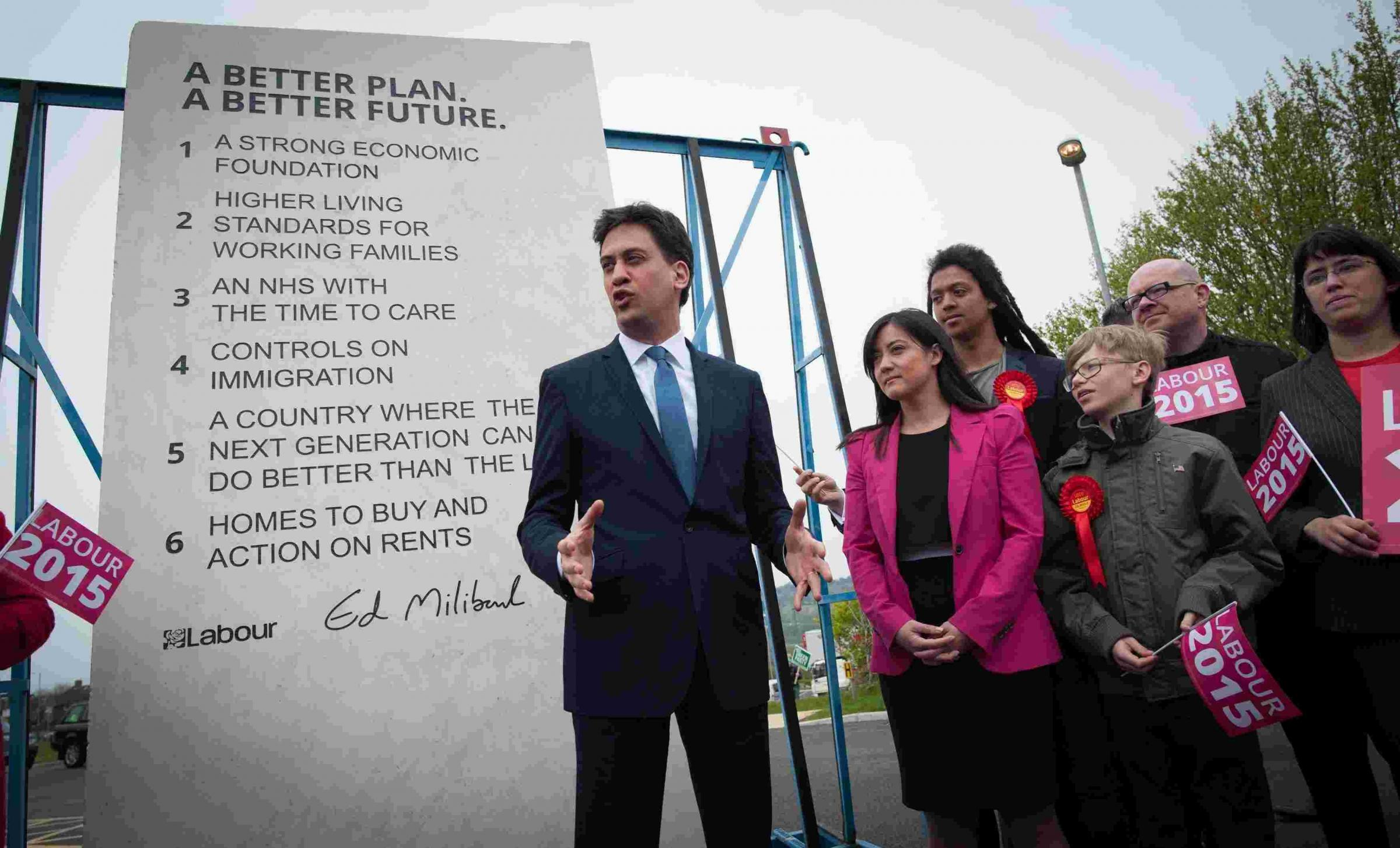 Ed Miliband with Labour's pledge stone