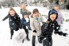 Children at Burnham Copse Primary School. in Tadley, have fun in the snow