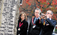 Hart District Council chairman Councillor Sean Haffey (centre) with his wife Colleen at the 25th RE Bomb Disposal re-enactment group's remembrance service at Hook war memorial