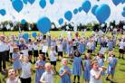 Pupils from Buryfields Infant School release balloons at the end of a week of learning about flight