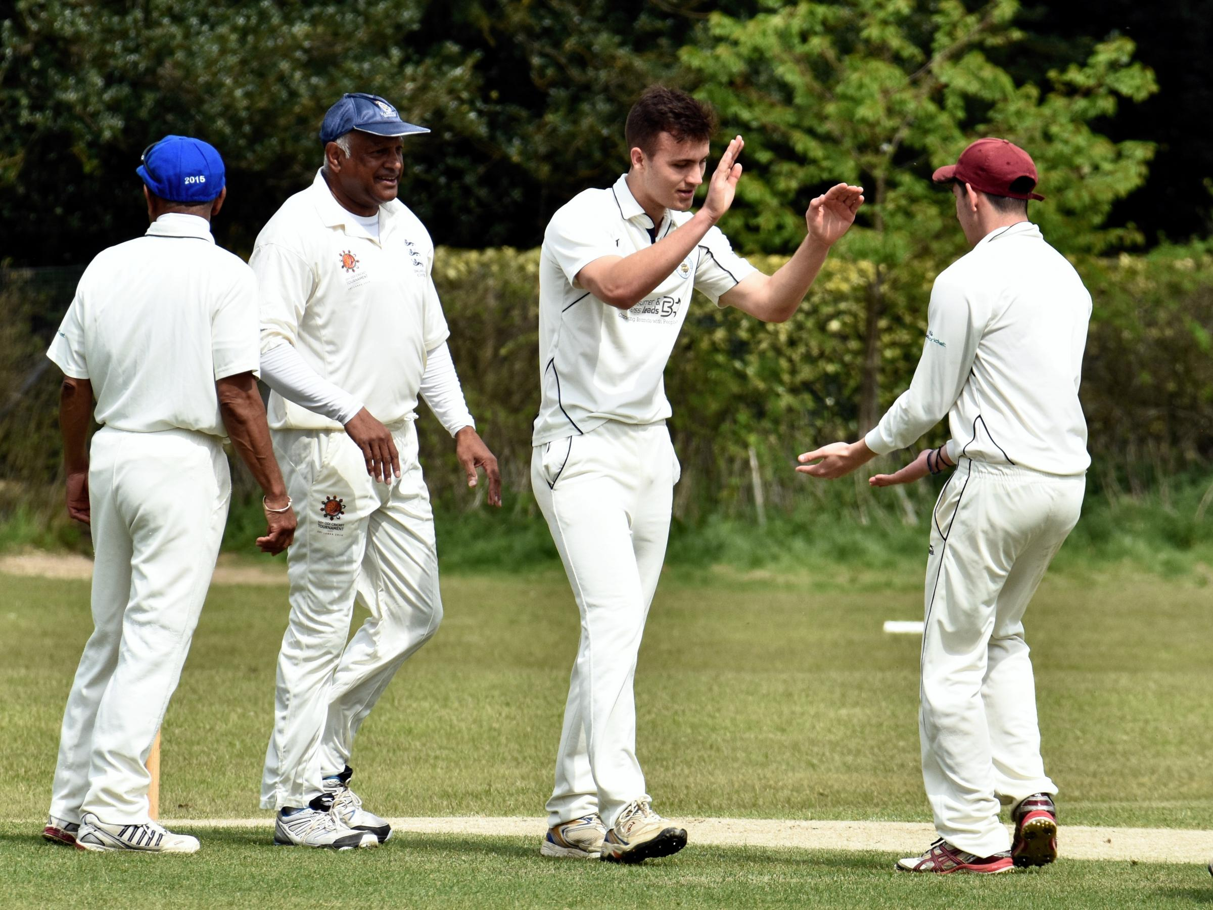 Basingstoke IIIs celebrate a wicket against Hobos