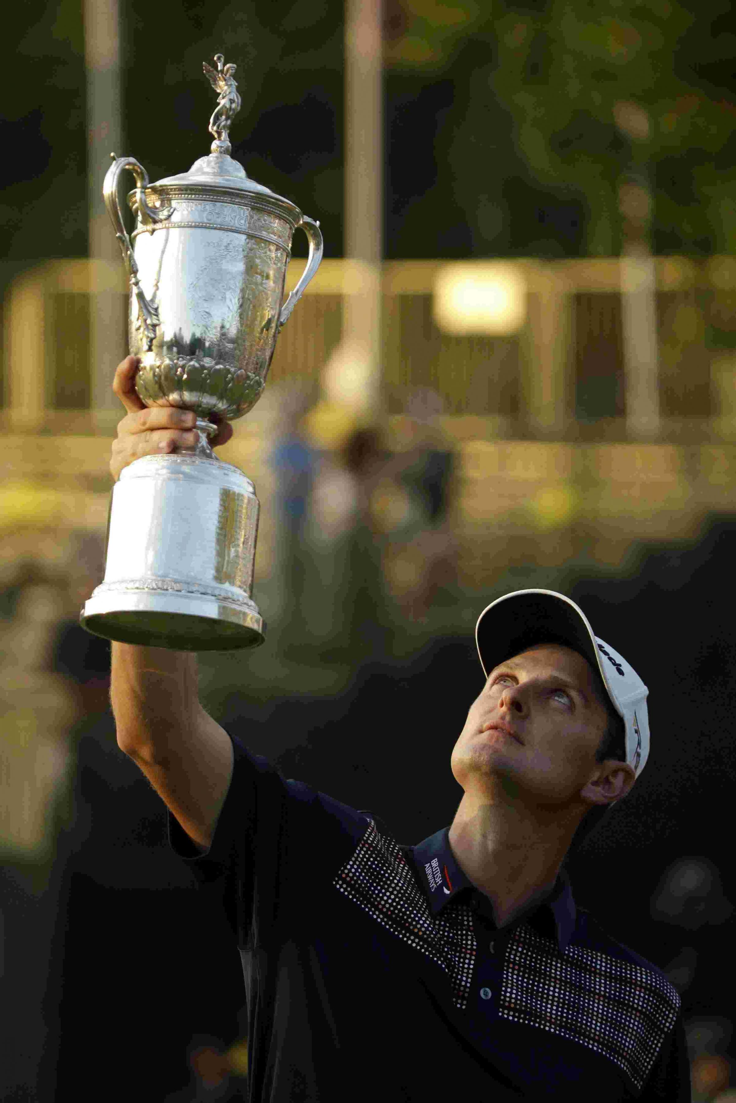 Justin Rose with the Us Open trophy