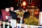 Birch Road, Baughurst.(L-R): Richard Saunders holding Albbi Saunders (2), Ethan Saunsers (5) and Charlie Reynolds (Richard's brother in-law), outside their Christmas house that they decorated in aid of the Forget Me Not charity.Photograph By: Sean Dil
