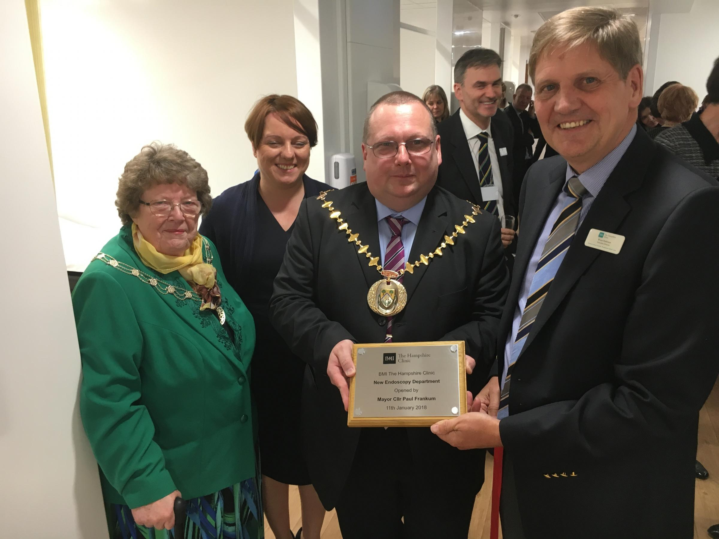 From left, mayoress Jane Frankum, Director of operations Nichol Freestone, mayor Paul Frankum, and executive director Bruce Robinson with a plaque to mark the official opening of the endoscopy unit at BMI Hampshire Clinic in Basingstoke