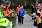 Basingstoke Park Run.Memorial Park, Basingstoke.Blind runner Tony Nicholls (41) from Winklebury completes his 100th park run with volunteer guide Candy Wong as fellow runners applaud him at the finish line.Mayor of Basingstoke & Deane Cllr Paul Frankum an