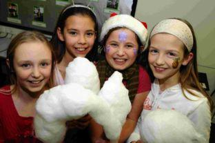FROM LEFT: Jessica Wells, nine, Martha Inglis, nine, Phoebe Ballard, nine, and Rachel Gordon, nine, enjoy the candy floss