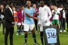 Kolo Toure and Vincent Kompany presented Yaya Toure with a plaque after his final home game for Manchester City (martin Rickett/PA)