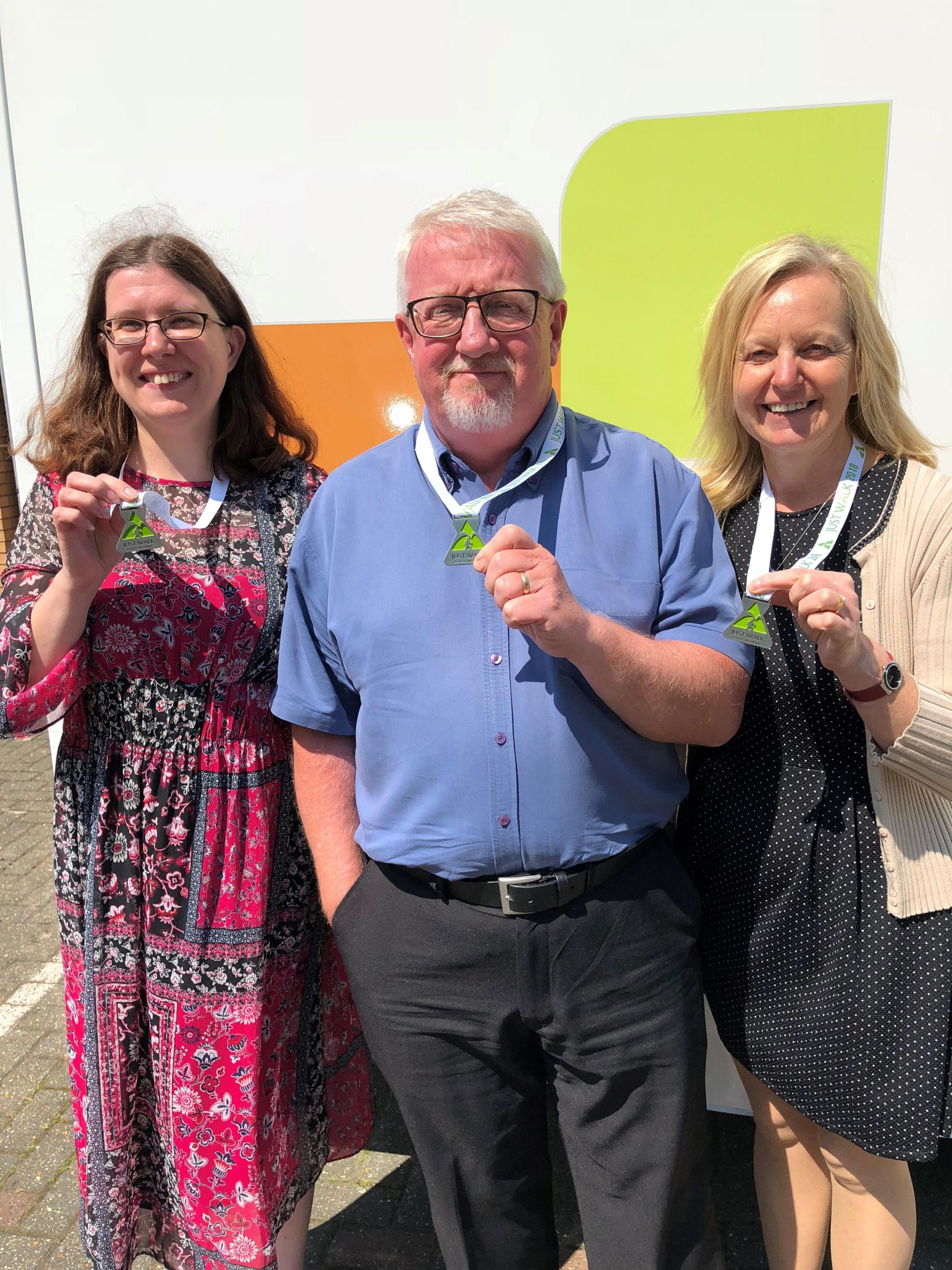 From left, Suzy Drewett, Alan McLaughlinand Alison Haynes with their medals