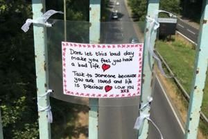Signs go up on bridges in town to help those contemplating suicide