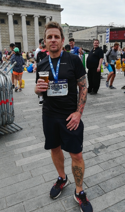 Darren Barham enjoys a celebration pint after one of his previous running feats