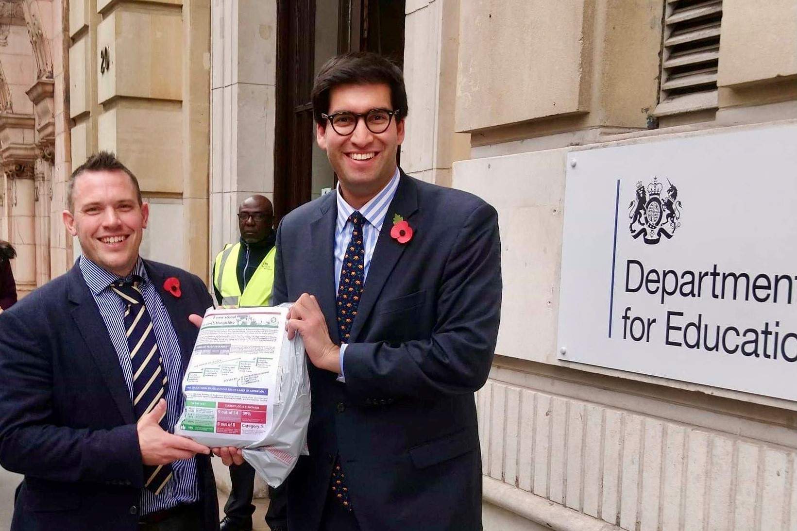Ranil Jayawardena MP (right) and Revd Dr Chris Evans handing in their application at the Department for Education
