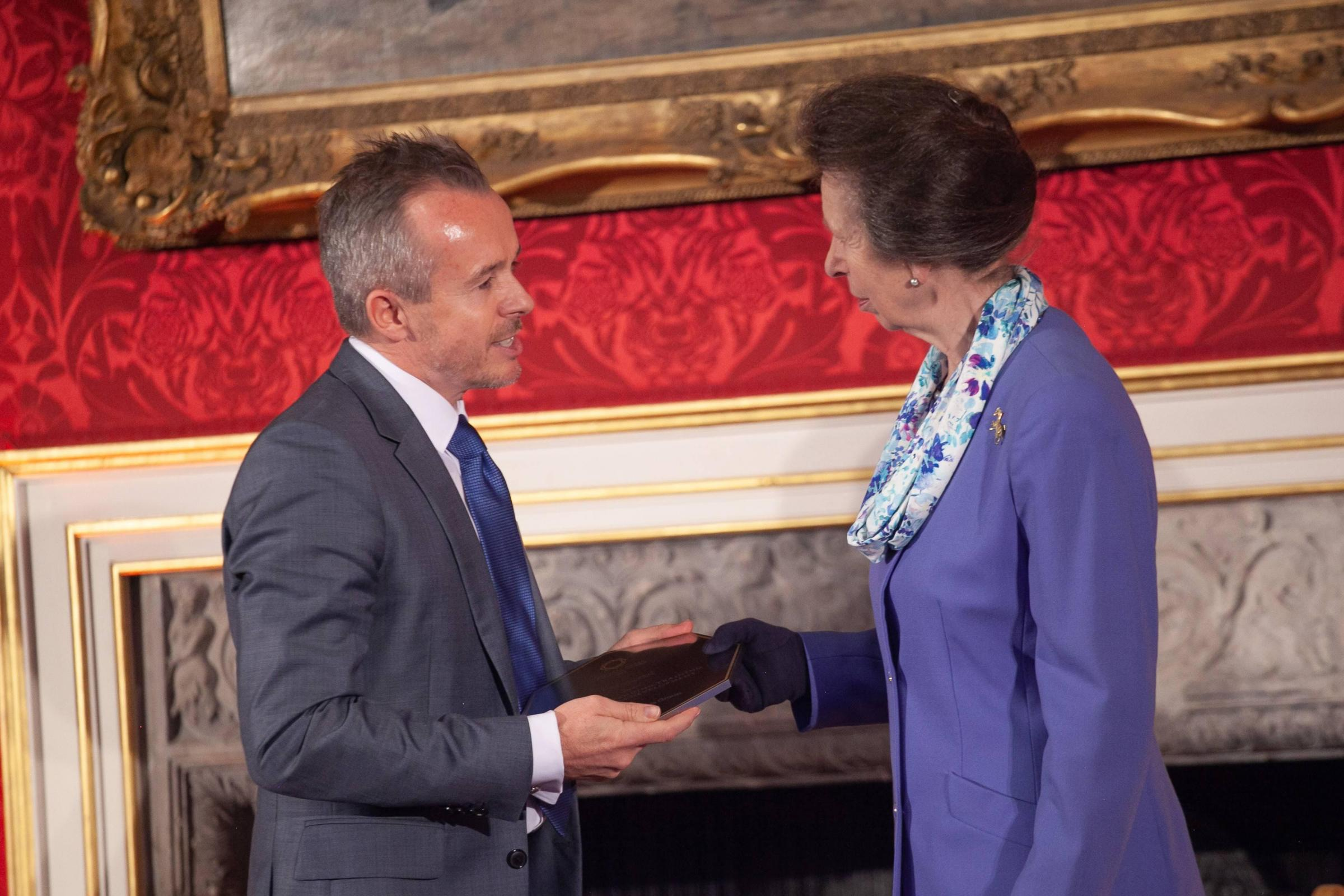 Princess Anne prsents Reassured with the award