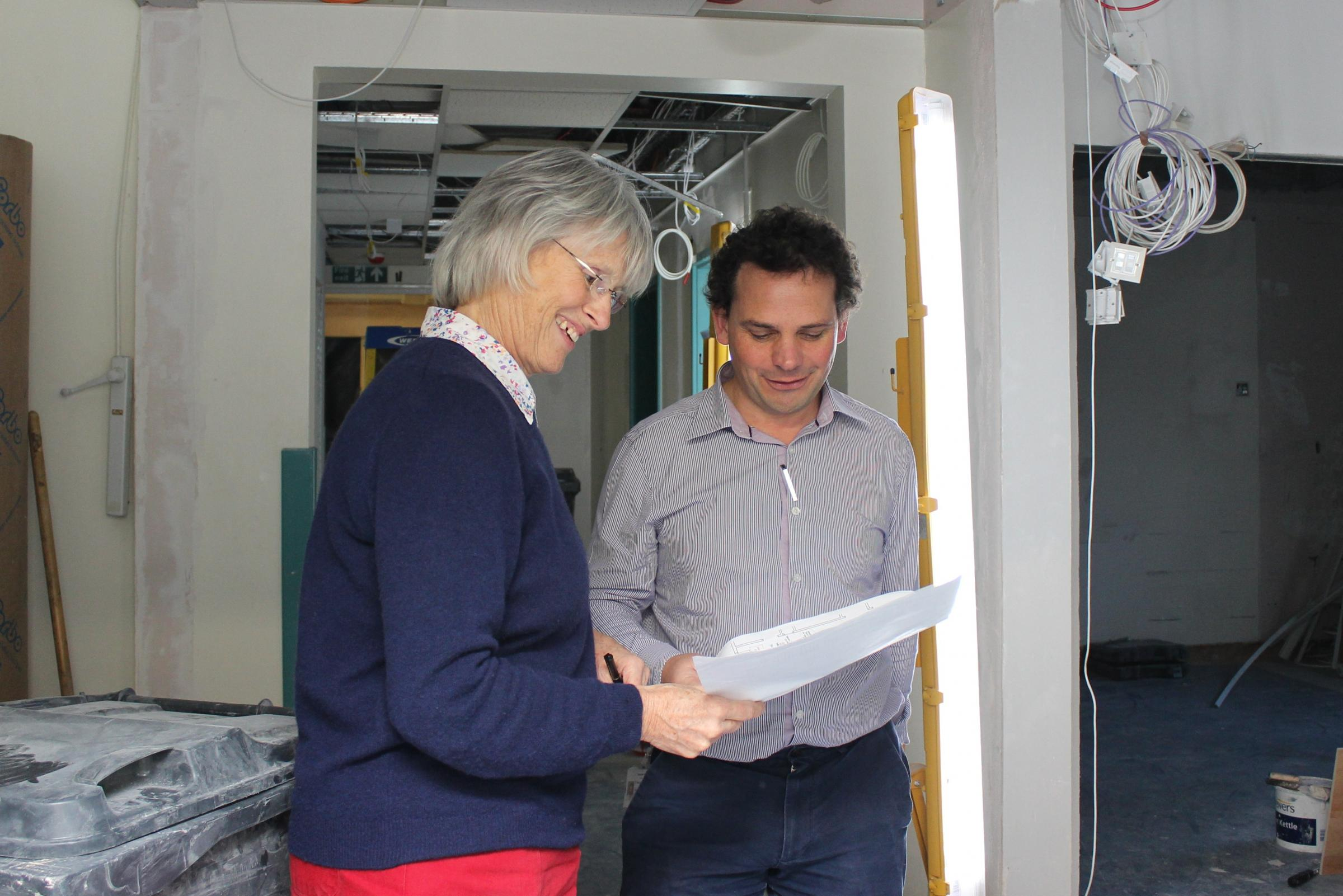 Trish LeFlufy, clinical services manager for child health, and Dr Nick Ward, consultant paediatrician, look at the plans for the new paediatric assessment unit at Basingstoke and North Hampshire Hospital.