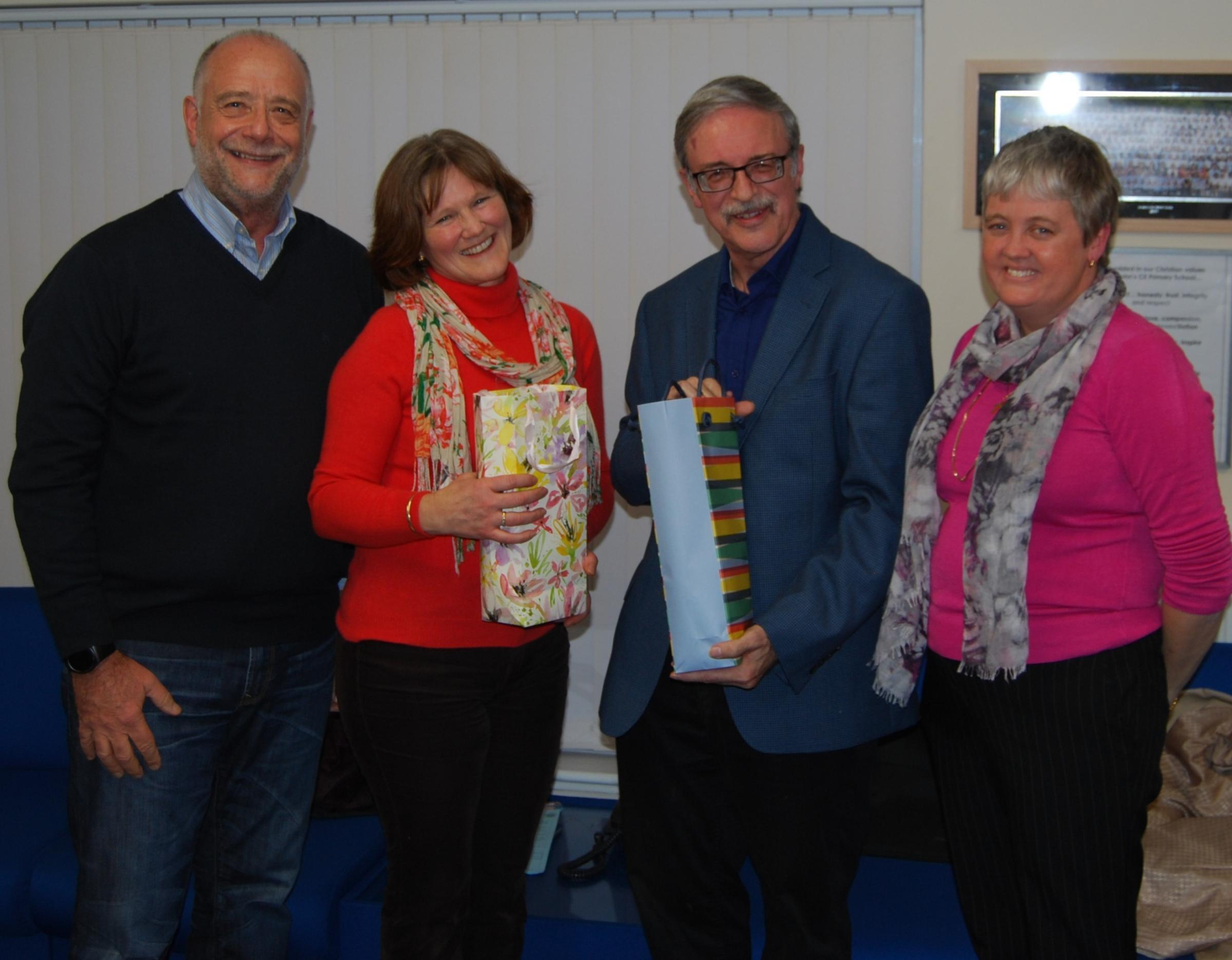 Outgoing governors at St John's Primary School. Donna Lincoln-Ohrstrand (centre left) and Allan Palmer (centre-right). Chair of Governors, Geoff Knappett (L) with headteacher Angela Nicholls (R)
