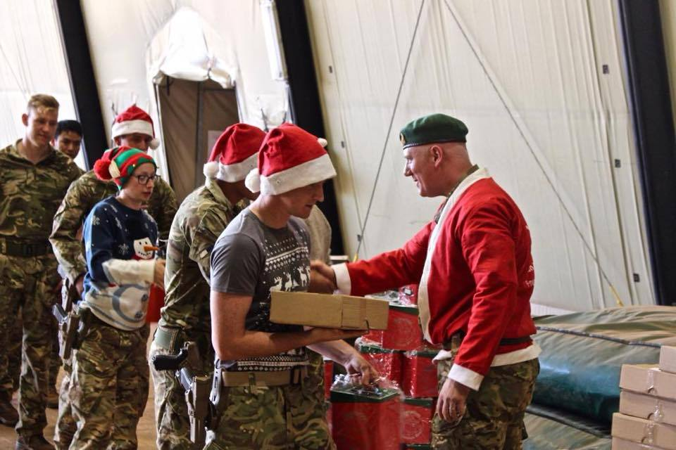 Gift boxes being given out to B flt 18 (B) squadron. Image: Odiham Parish Council
