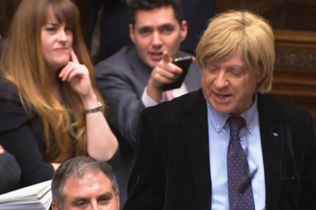 Michael Fabricant directs a question to Theresa May during Prime Minister's Questions