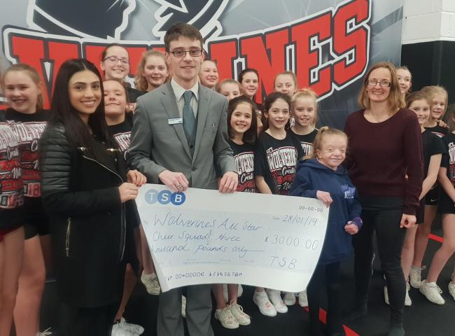 TSB funds presented to Wolverine's Cheer Squad