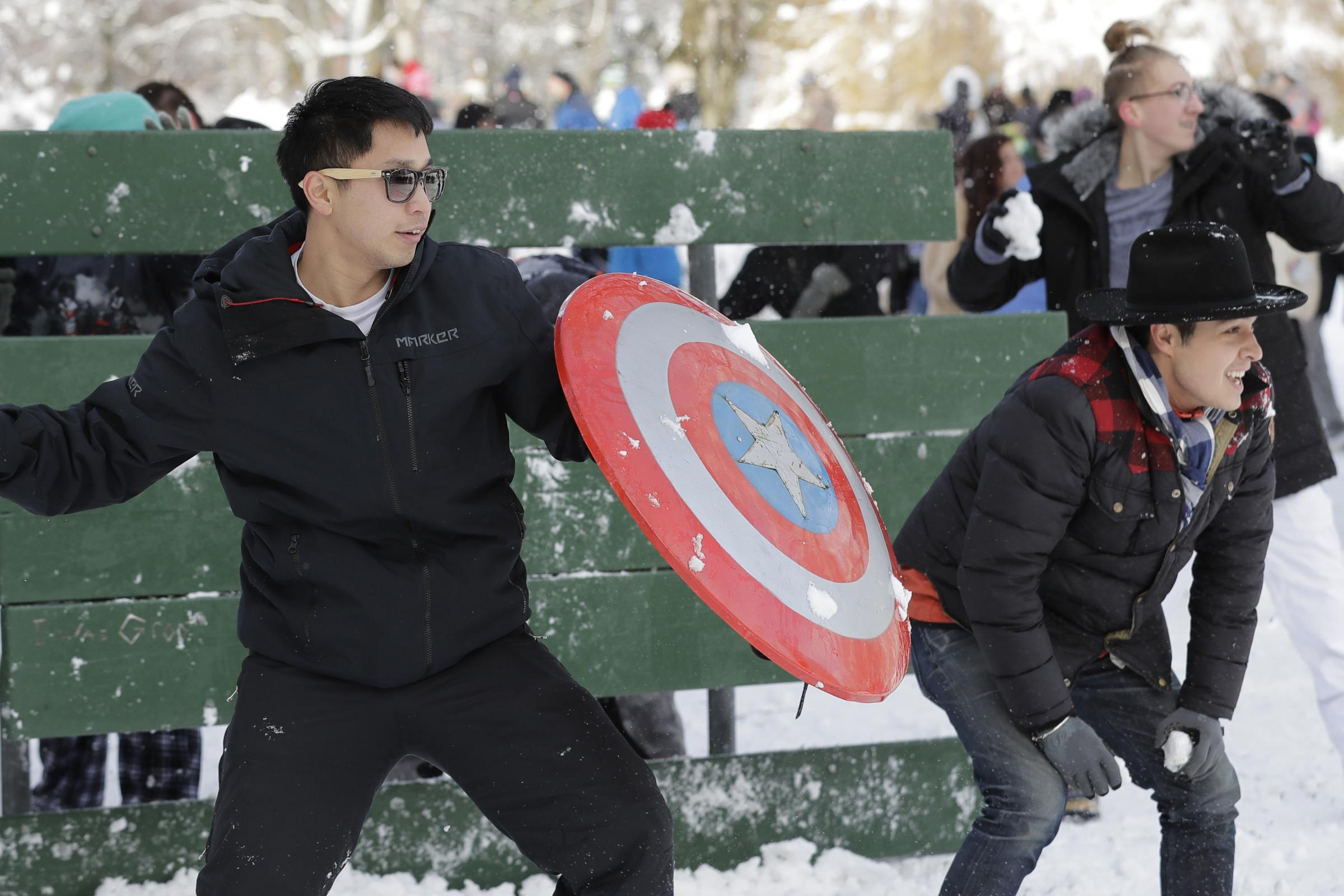 People armed themselves with shields while taking part in a public snowball fight in Tacoma, Washington