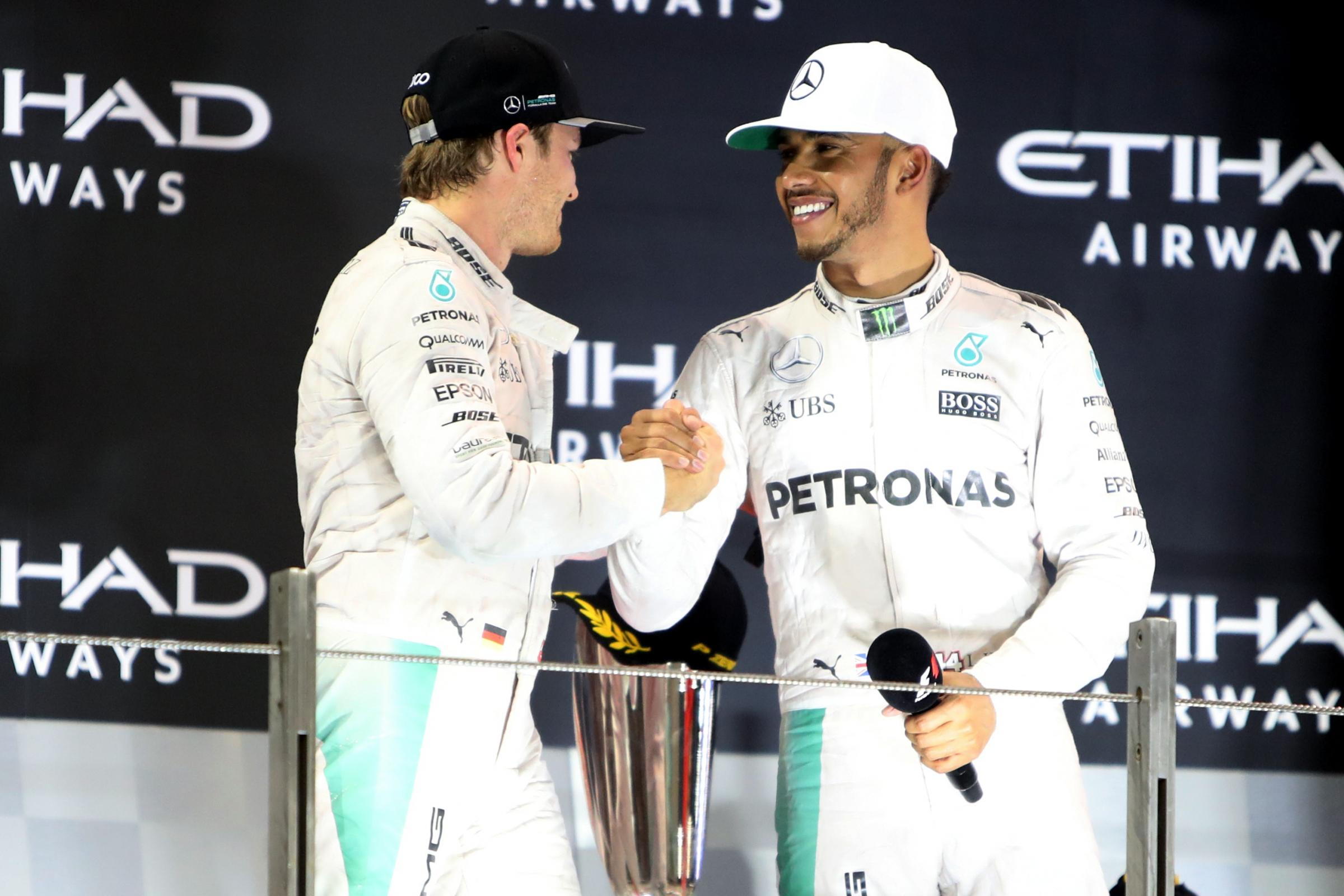 Nico Rosberg (left) has backed Lewis Hamilton (right) to claim a sixth world title this season