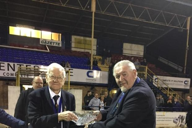 Peter Raynbird presented with his crystal bowl by Mick Davis