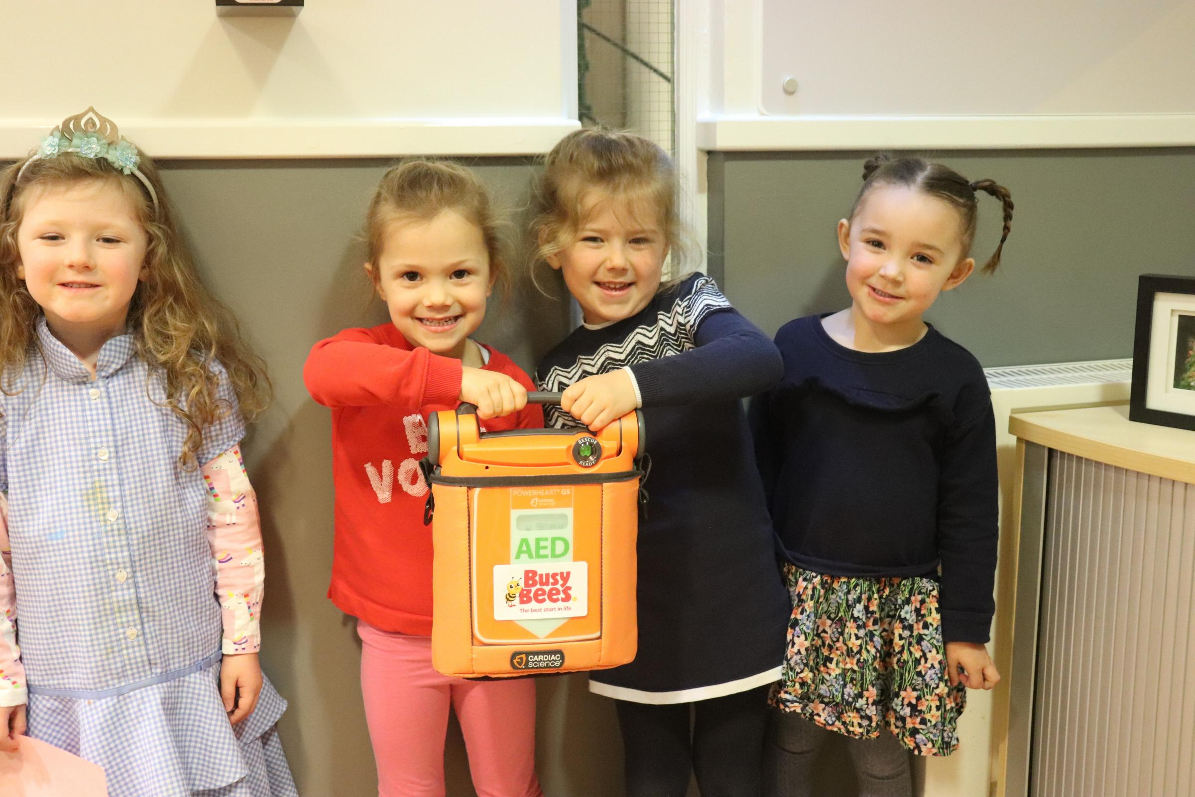 Children at Busy Bees Nursery Basingstoke Chineham with the new automated external defibrillator