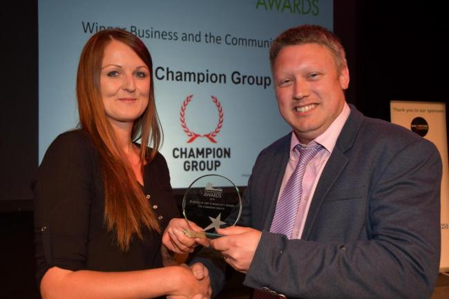 Kevin Croombs from the Champion Group receives the Business and the Community award from Lucy Boazman from Basingstoke Together last year. Image: Sean Dillow