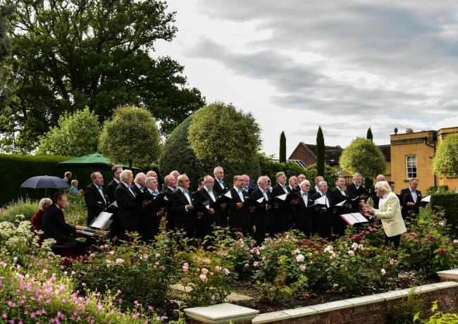 Members of Basingstoke Hospital Male Voice Choir performing at the Music in the Garden event which raised £70,000 for Ark Cancer Centre Charity in 2016. Image: Peter Markwick