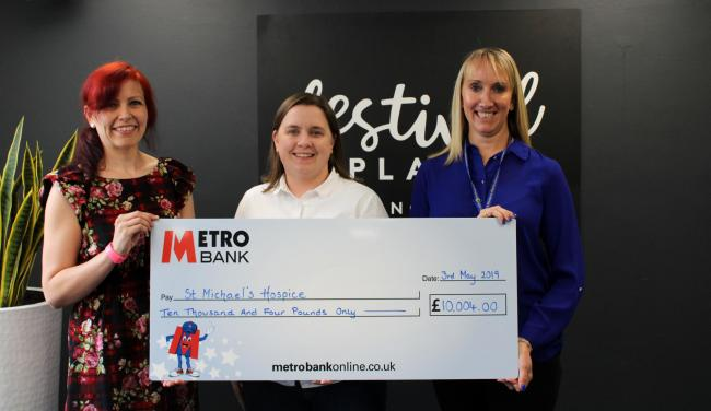 Sally Blanc, Stacey Richardson and Nicola Lawrence presenting a cheque for £10,004 to St Michael's Hospice
