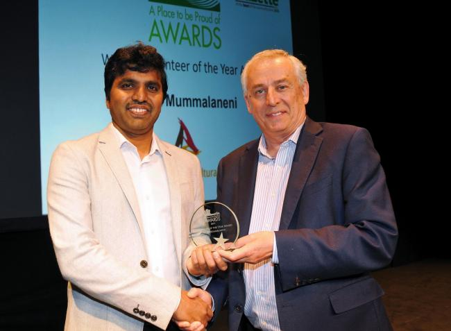 Arun Mummalaneni, Volunteer of the Year Award winner, with Gazette publisher Bill Browne