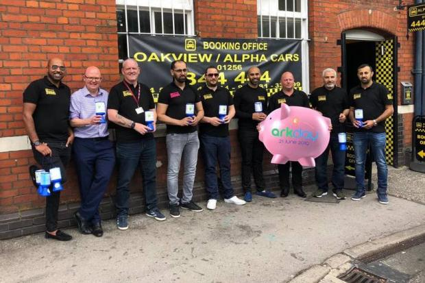 Mark Jones, second left, Shaid Khaliq, centre, and members of the Alpha Cars team who are supporting Ark Day