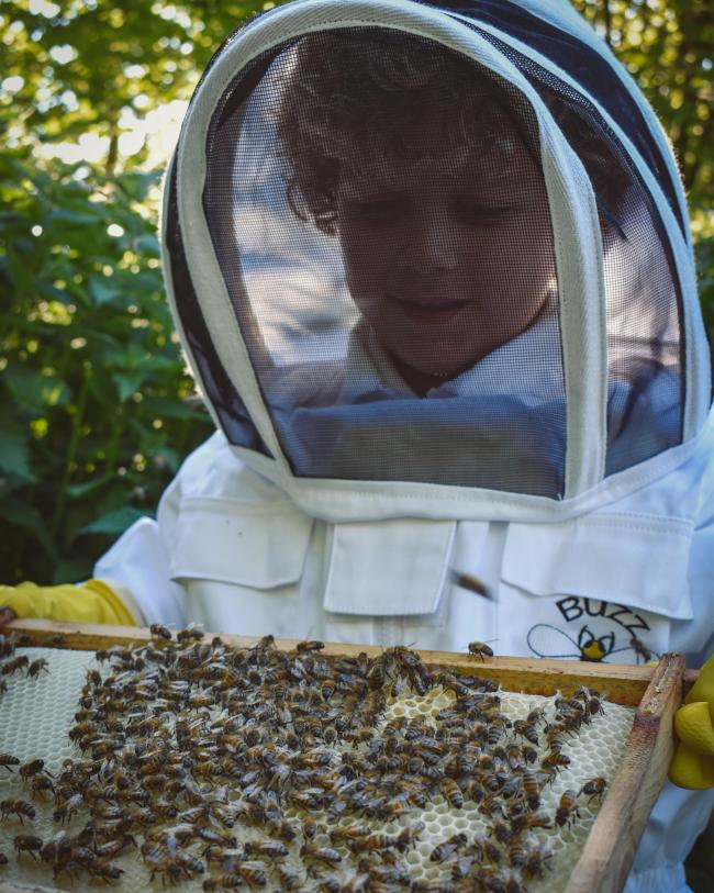 Jace Huggins in his beekeeping gear
